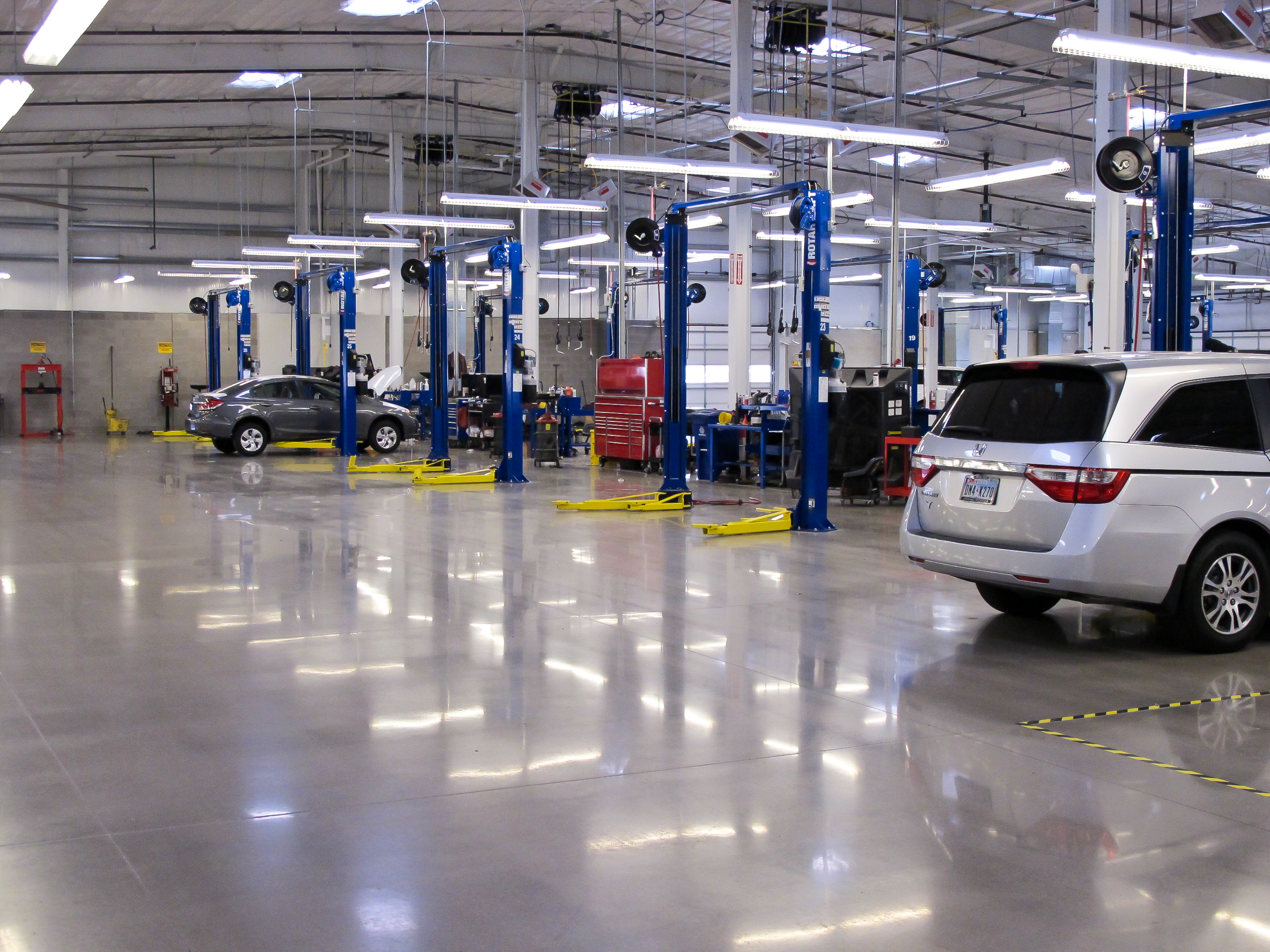 First texas honda dealership renovates with micro toppings for Polished concrete maintenance