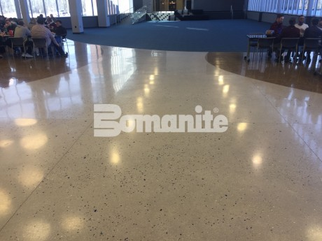 Infinite Campus creates a natural cafeteria floor beach theme with sea shells using Bomanite Custom Polishing Systems Modena Monolithic and Renaissance Deep Grind in Blaine Minnesota