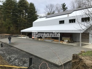 Residential Backyard Artist Studio Utilizes Grasscrete for Pervious Parking and Stormwater Managment installed by Premier Concrete Construction located in Massachusetts