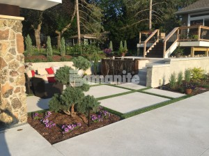 Backyard Landscaped and Designed with Bomanite Concrete Systems, Exposed Aggregate, Bomanite Revealed, Bomanite Antico Process, Bomanite Imprinted Concrete, Bomanite Thin-Set Overlay creating entertaining spaces, courtyards, pool decks and cabanas
