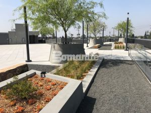 LAFC Stadium Los Angeles Futbol Club inspired by Bomanite Exposed Aggregate Systems Sandscape Texture and Bomanite Alloy Paving and Walkways with a specialty Flight Wall and Rooftop Deck created for Fans
