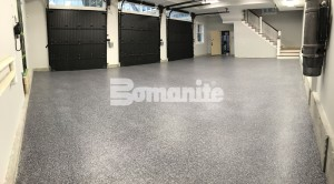 Essex County Estate places Bomanite Topping system Broadcast Flake in two large residential garages for low maintenance and design