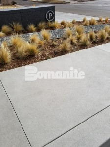50 Fifty DTC incorporates Bomanite Sandscape Refined Exposed Aggregate for the decorative concrete curbs and walkways and under the porte cochere installed by Colorado Hardscapes in Denver, CO to bring the Nautical Design to life