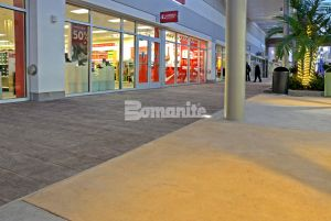 Tanger Outlet Daytona Beach designs Bomacron Boardwalk stamped concrete pattern in lounge area and walking paths installed by Bomanite Licensee Edwards Concrete Company located in Winter Garden, FL