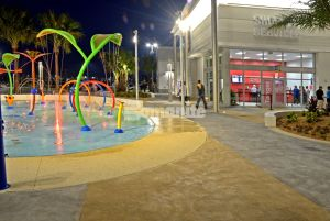 Tanger Outlet Daytona Beach creates Bomanite Decorative Concrete splash pads to mimic the ocean and sand beach vibe installed by Bomanite Licensee Edwards Concrete Company located in Winter Garden, FL