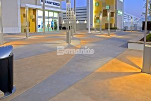 A racetrack checkerboard theme in two tone concrete colorants is installed by Edwards Concrete for the Tanger Outlets Daytona
