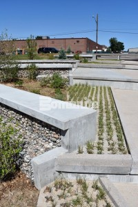 Bomanite Grasscrete Partially Concealed System is a pervious monolithic cast-in-place concrete suitable for this gabion tiered drop structure detention pond located in Denver, CO that was planted with varying grasses for greenspace and stormwater management.