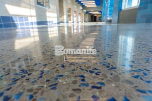 Grain Valley High School worked with Hollis + Miller Architects to renovate and expand their rapidly growing community and enlisted Musselman & Hall Contractors to install the Bomanite Modena SL Custom Polishing System for their main entrance and hallways with a blue glass and mirror glass mix of aggregates.
