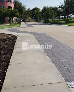 Valley Children's Healthcare Network implements their Landscaping Master Plan Phase 2 with Bomanite Decorative Exposed Aggregate Revealed and Sandscape Texture Systems installed by Heritage Bomanite located in Fresno, ca creating an artistic yet functional design for fundraising events and vehicle traffic.