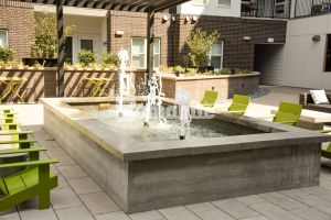 CoLab Cohousing located in Denver Colorado created a stylish student living community with a board formed water feature installed by Bomanite Licensee, Colorado Hardscapes, providing a relaxing atmosphere to just hang out and enjoy your neighbors