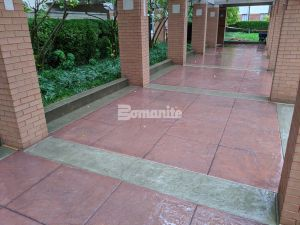 Residence Condominiums in Clayton, MO installed the best of the Bomanite systems using Bomanite Imprinted Concrete with the Bomanite Sandscape Texture Finish to create a beautiful stylish functional driveway and entryway installed by Musselman & Hall Contractors, LLC