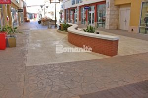 Tanger Outlets Opened their Fort Worth Location with Texas Themed Walkways Using Bomanite Imprint Systems throughout the hi-end shopping center installed by Texas Bomanite with design by Adams & Associates
