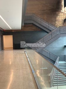 Dallas Holocaust and Human Rights Museum moves into their newly built facility designed by Omniplan with an industrial modern Bomanite polished concrete floor installed by Texas Bomanite
