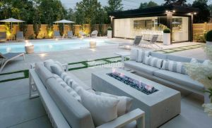 The Homeowners sought out Bomanite Toronto in Canada for a sleek backyard pool deck using the Bomanite Sandscape Refined Exposed Aggregate System with bands of grass.