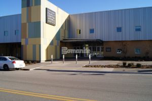 Bomanite of Tulsa, placed artistic decorative concrete walkways consisting of Bomanite Sandscape Texture Exposed Aggregate with several different colors of gray Bomanite Con-Color to provide an inviting exterior space and entrance to the Family Center for Juvenile Justice Facility.