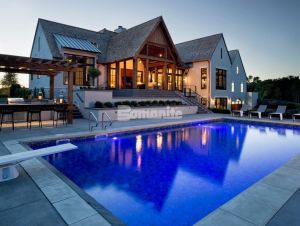 Luxury Home Builder, Hendel Homes chose Bomanite Licensee Concrete Arts for the spacious pool deck installation for their clients modern Tudor style new home, using Bomanite Sandscape Refined Antico Exposed Aggregate provides them with the sophistication and safety desired.
