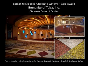 Bomanite of Tulsa, Inc. Tulsa OK installed a custom Bomanite Revealed Exposed Aggregate System with colors of White, Red, Yellow and Black Aggregates along with the Bomanite Sandscape Texture Exposed Aggregate System in Autumn Brown to identify with the Choctaw Cultural Center's Heritage earning them a Gold Award at the Bomanite Decorative Concrete Annual Awards Program