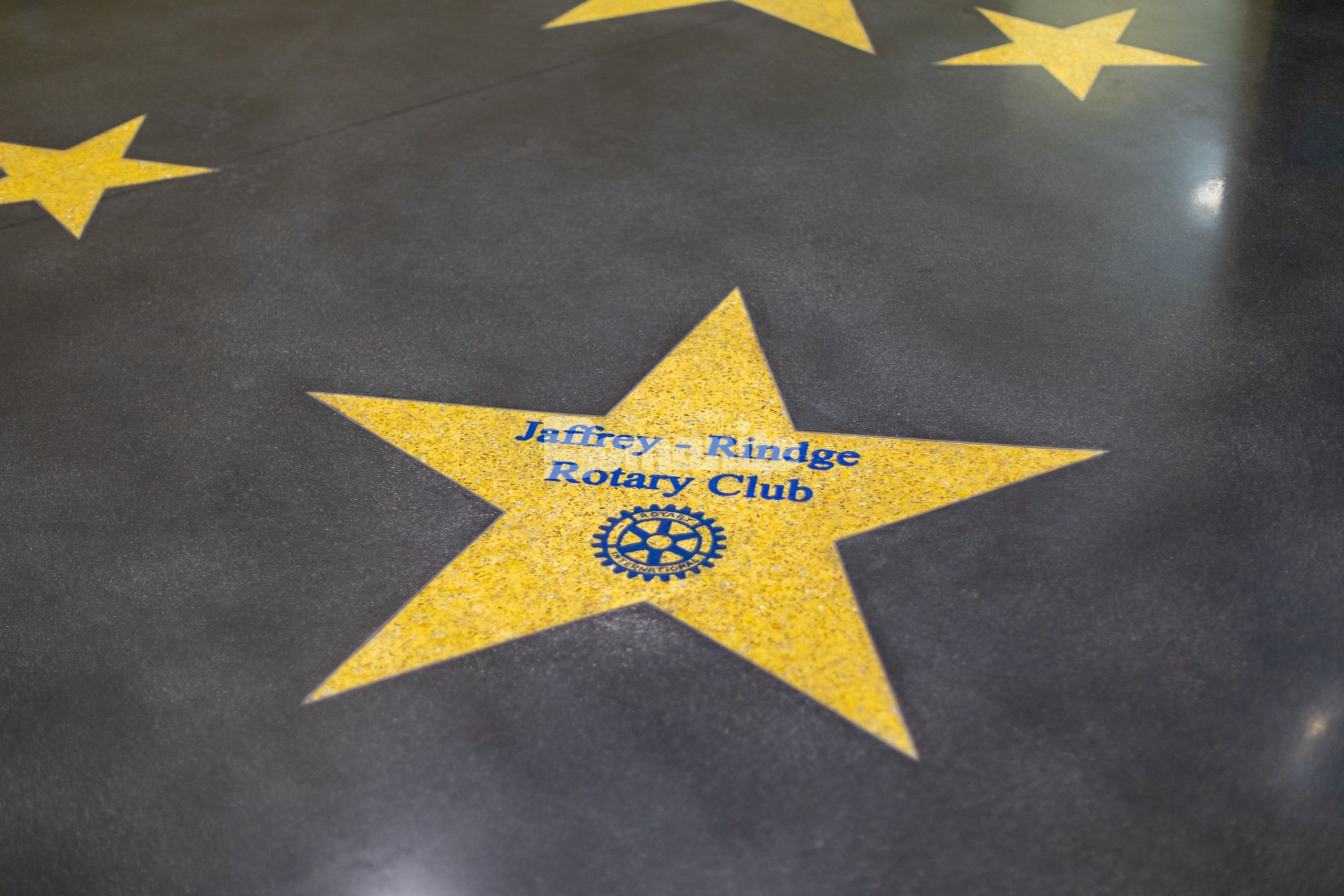 Premier Concrete Construction brought to life the Hollywood walk of fame in the main lobby of the Jaffrey Park Theatre with a sleek dark Bomanite Renaissance Polished Concrete Floor as the background to the Golden Stars engraved with donor names in brilliant blue created with the Bomanite Modena TG system.
