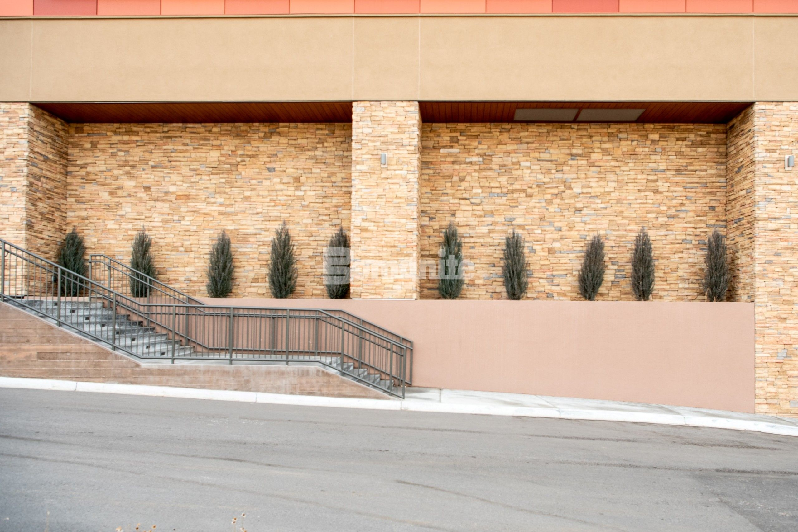 Colorado Hardscapes used the Bomanite Micro-Top ST system to correct a previous poured board formed wall installation and bring them up to code that now accent the exterior finishes on the building and provide a smooth and sleek appearance.