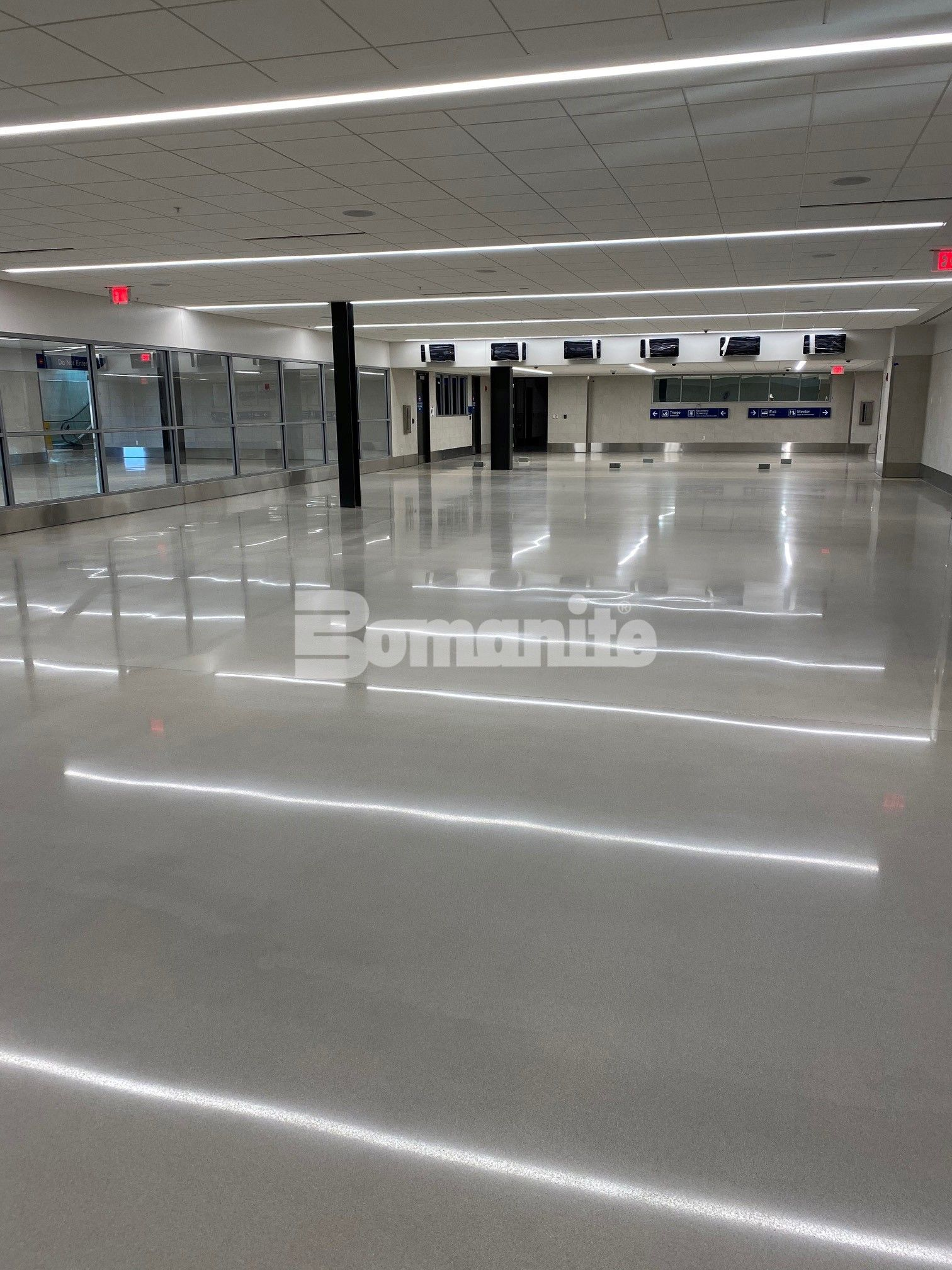 Brownsville International Airport Renovates Passenger Terminal with Bomanite Modena SL Custom Polished Concrete in Nickel Gray installed by Texas Bomanite Licensed Contractor